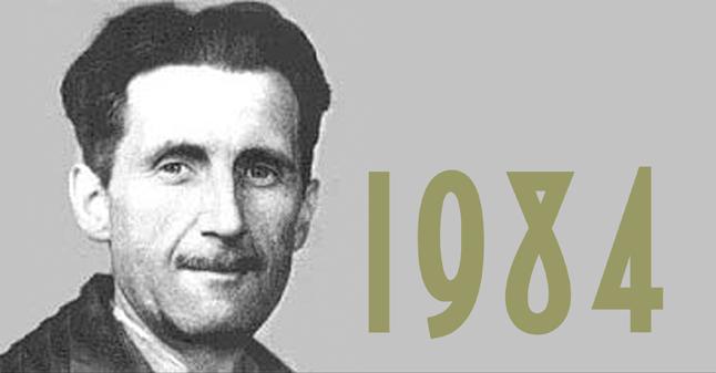 Una foto di George Orwell, accanto la scritta 1984